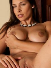 Brunette beauty Zafira A offers you her tight pussy on the couch