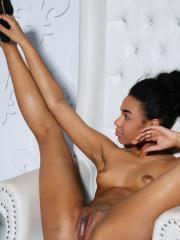 Ebony girl Gana strips naked and offers you her wet pussy