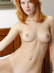 Gorgeous redhead Mia Solis offers you her forbidden fruit in bed