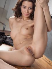 Brunette hottie Lanya shows off her long legs and tight pussy