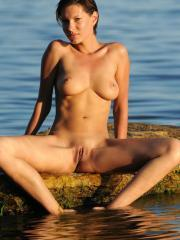 Busty babe Suzanna A shows off her nude body on the beach
