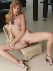 Busty redhead Monika A shows off her sexy curves and tight pussy