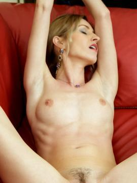 Blonde babe Janelle B strips out of her lingerie in Omusa