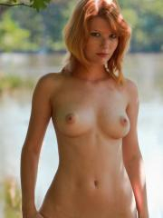 Redhead babe Mia Sollis strips out of her dress in Geran