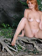 """Busty redhead Violla A strips out of her swimsuit in """"Adoca"""""""