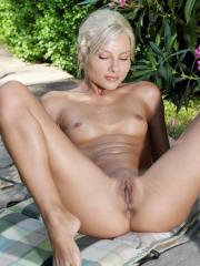 Pictures of blonde bombshell Adelia A completely naked outside