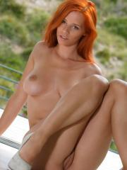 Wearing a sexy gray dress, Ariel exudes an elegant yet naughty sizzler as she poses her gorgeous body into a variety of poses all over the veranda