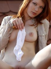 Redhead beauty Mia Sollis exposes her pussy and spreads her legs outside