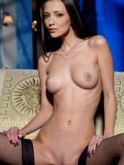 Stunning brunette beauty Anna AJ strips out of her black lingerie