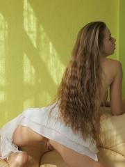 Milena D flips her long, beautiful hair to the side and exposes her amazing breasts