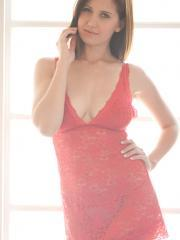 Chrissy Marie strips off her red lingerie by the sunlit window