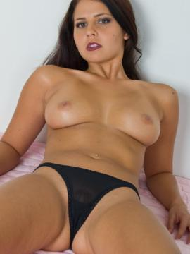 Cali Logan strips naked for you in bed