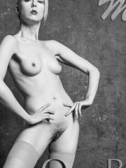 Nude ballerina Magdalene does her ballet poses in the studio