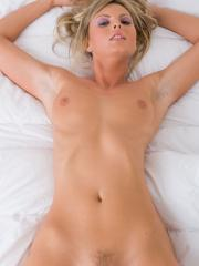 Blonde babe Kae gives you her stunning body in bed