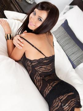 Pictures of Natasha Belle waiting for you in bed in black lingerie
