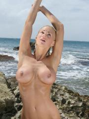 NaughtyAllie sets her tatas free out in open on public beach