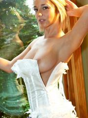 Busty babe Nikki teases in a sexy white corset