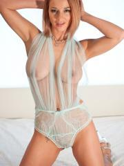 Nikki Sims waits for you in bed wearing her totally sheer lingerie
