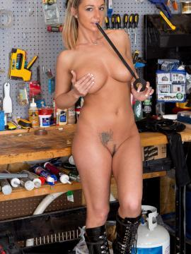 Busty babe Nikki Sims gets kinky with electrical tape