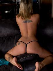 Beautiful girl Nikki Sims teases in her black thong