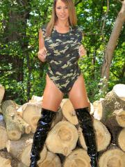Busty hottie Nikki Sims teases in her camo swimsuit