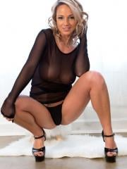 """Nikki Sims teases with her long legs and black lingerie in """"Black Sheer"""""""