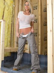 """Busty babe Nikki Sims strips and teases in """"Construction"""""""