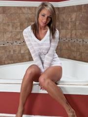 Pictures of hot girl Nikki getting all hot and wet for you