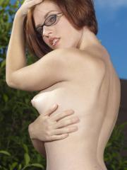 Pictures of amateur girl Molly showing her boobs outside