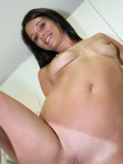 Fresh faced coed Dixie Brooks tickles her clit with a magic wand