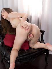 Gorgeous babe Stefany teases her soft shaved pussy