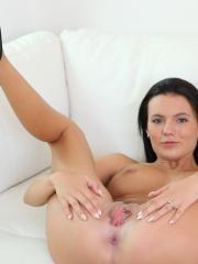 Busty brunette Vanessa Decker strips naked and masturbates with her dildo