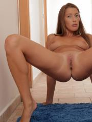 Nubile Elissa flexes her long legs and fingers her sticky pussy