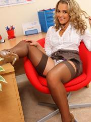 Wonderful blonde Jodie Gasson strips in her tight pencil skirt and stockings