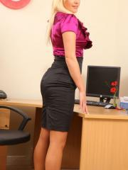 Beautiful blonde Amy Green in saucy secretary strip.