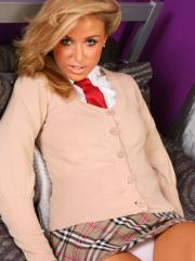 Curvy blonde schoolgirl Rosie Whiteman strips in a tight white shirt and cardigan