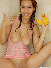 Pictures of Tania getting wet in her pink lingerie