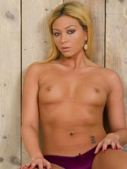 Blonde girl Natalia Forrest strips down to her high heels and uses her red vibrator
