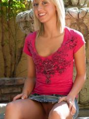 Beautiful blonde teen Kelly shows off her puffy nipples and tight pussy upskirt