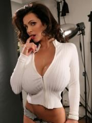Busty glam model Denise Milani teases in her tight sweater