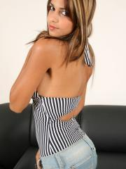 Polliana teases and holds her full tits out of a black and white striped one-piece.