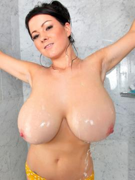 Rachel steps out of a steamy shower flaunting her big boobs