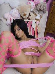 Pictures of Raven Riley masturbating in bed