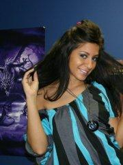 Pictures of Raven Riley playing with her moist vagina