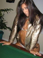 Pictures of teen girl Raven Riley playing a hot game of pool