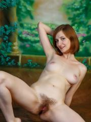 """Redhead cutie Melody spreads her pussy for you in """"Colunni"""""""
