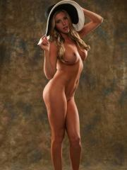 Samantha Saint poses in a pretty hat and high heels and absolutely nothing else