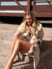 Gorgeous girl Samantha Saint shows off her beautiful long legs outside
