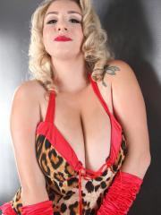Sexy pinup model September Carrino teases in leopard print lingerie