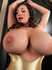 Big titted September Carrino lets her breasts out of her bikini